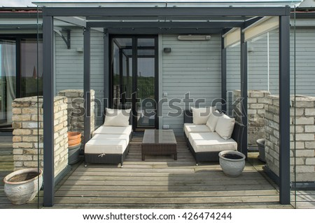 Veranda on the roof. Modern private flat. - stock photo