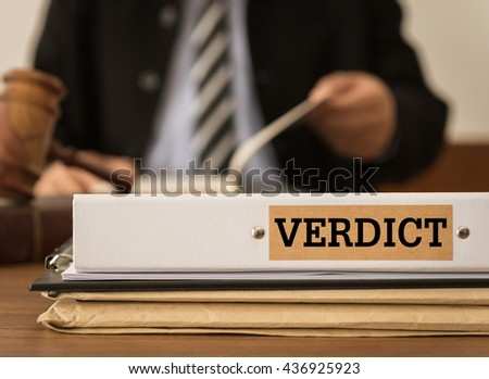Verdict document folder on the desk of the judge. Concepts of law, legal.