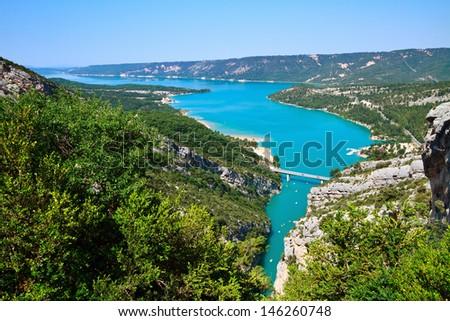 Verdon river flows into the artificial lake of Sainte-Croix-du-Verdon, France. - stock photo