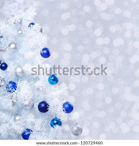Verical closeup photo of white decorated christmas tree - stock photo