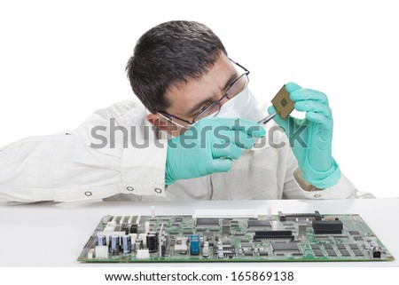 Verifying microchip with magnifying glass on white background - stock photo
