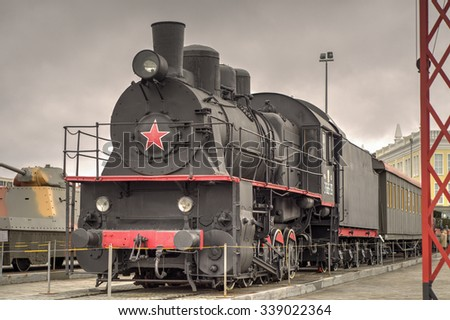 VERKHNYAYA PYSHMA, YEKATERINBURG, RUSSIA - October 18, 2015: Photo black locomotive of the Soviet period a cloudy day in dark colors
