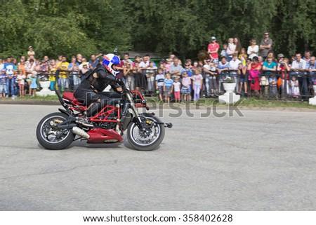 Verkhovazhye, Vologda region, Russia - August 9, 2014: Motorcycle show in village Verkhovazhye. Alexey Kalinin motorcycle accelerates - stock photo