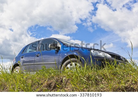 Verkhovazhye, Vologda region, Russia - June 16, 2015: Volkswagen Golf on the sky background