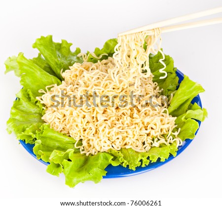 Vermicelli and lettuce. Isolated on a white background - stock photo