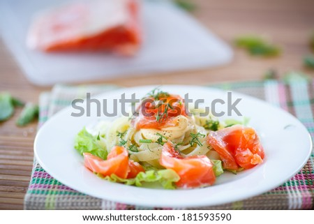 vermicelli with salted salmon and sauce on lettuce leaves