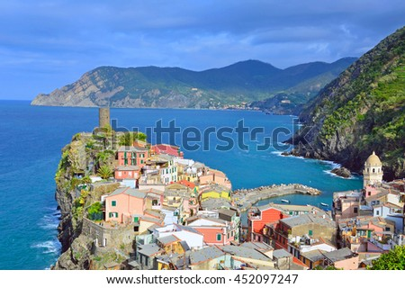 VERNAZZA, ITALY - JUNE 16 2016: Vernazza is a small village in the Cinque Terre and local people have built colorful houses on rocky, steep territory overlook the Liguria sea.