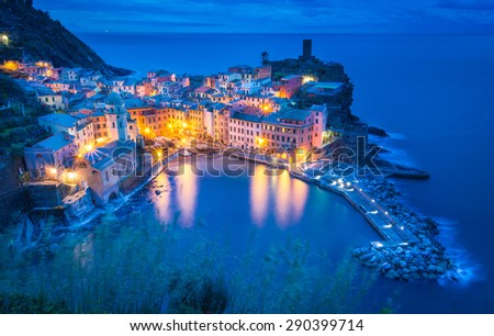Vernazza, Liguria, Italy. The beautiful village of Vernazza as you can see it from the muntain above, during the blue hour. - stock photo