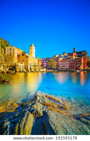 Vernazza village, church, rocks and sea harbor on sunset, Seascape in Five lands, Cinque Terre National Park, Liguria Italy Europe. Long Exposure. - stock photo