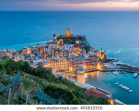 Vernazza village, Ocean Rugged Coast Harbour Aerial View Panorama Scenic Postcard view under Dramatic Sky Blur Cloud at sunset in Summer. Cinque Terre National Park, Liguria Italy - stock photo