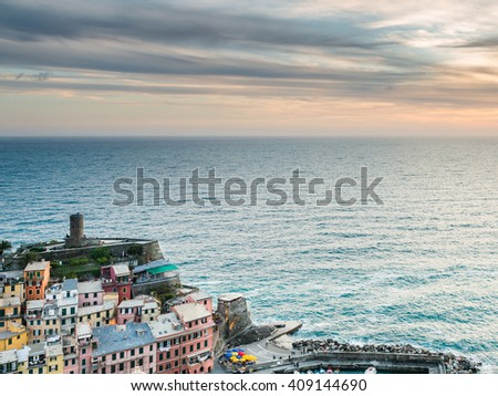 Vernazza village, Ocean Rugged Coast Harbour, Castello Doria Aerial View Panorama Scenic Postcard view under Dramatic Sky Blur Cloud at twilight in Summer. Cinque Terre National Park, Liguria, Italy - stock photo