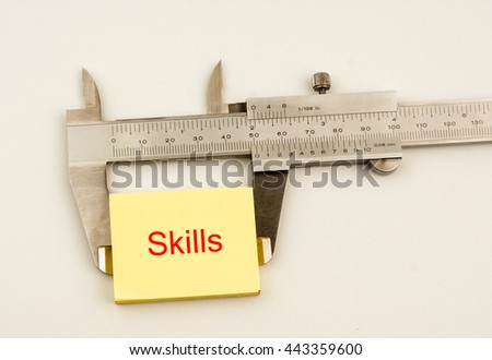 Vernier Caliper and yellow note with word skills - stock photo