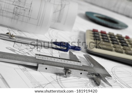 vernier callipers , calculator, compasses, grinding disc, and drawings