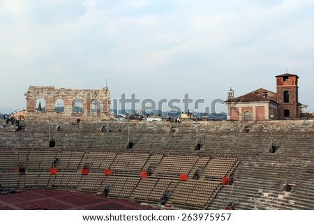 Verona Arena Veneto Italy. Cloudy day, early afternoon. Inside Roman amphitheatre. Preparation for opera show in the Arena of Verona. Some visitors inside. March 23, 2015
