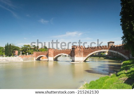 VERONA,ITALY-APRIL 26,2012:view of the banks of the adige river under the Castelvecchio Bridge in verona during a sunny day.