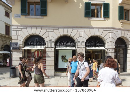 VERONA, ITALY � AUGUST 25: An outlet for Louis Vuitton on August 25, 2013 in Verona Italy. From 2006�2012 LV was named the world's most valuable luxury brand. It was valued in 2012 at US$25.9 billion. - stock photo