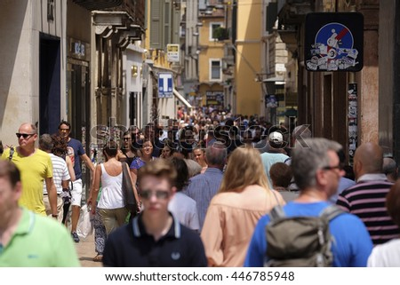 VERONA, ITALY - JULY, 2, 2016: CROWD OF TOURISTS ON A STREETS OF VERONA - ONE OF THE MOST BEAUTIFUL ITALIAN CITIES - stock photo