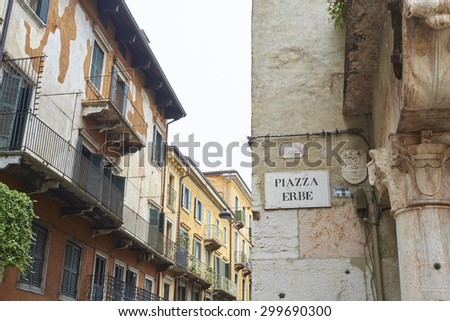 VERONA, ITALY - JULY 13: Detail of wall with street sign in Piazza Erbe. July 13, 2015 in Verona.