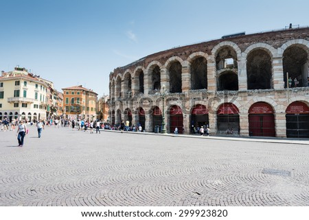 VERONA, ITALY - JUNE 3: Tourists at the Arena of  Verona, Italy on June 3, 2015. The amphitheatre could host more than 30,000 spectators in ancient times. Foto taken from Piazza Bra. - stock photo