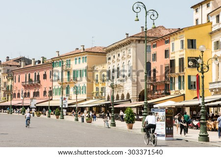 VERONA, ITALY - JUNE 3: Tourists at the Piazza Bra in  Verona, Italy on June 3, 2015. Verona is famous for its amphitheatre that could host more than 30,000 spectators in ancient times. - stock photo