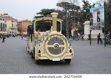 VERONA, ITALY - MARCH 17: A city sightseeing bus at Piazza Bra on March 17, 2015 in Verona. - stock photo