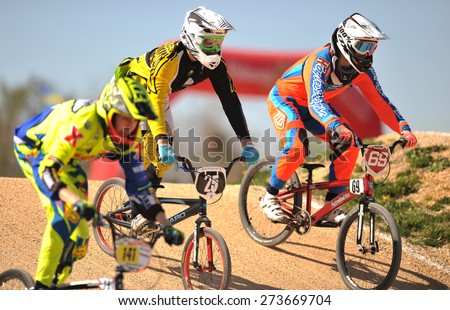 "VERONA, ITALY - MARCH 28: BMX riders on March 28, 2015 in Verona, Italy. This competition included riders from many European countries at the ""BMX Olympic Arena"" in Verona. - stock photo"
