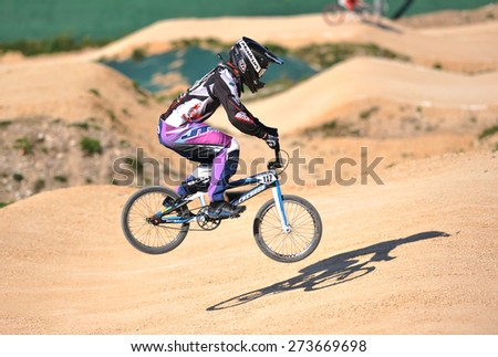 "VERONA, ITALY - MARCH 28: Unidentified BMX rider on March 28, 2015 in Verona, Italy. This competition included riders from many European countries at the ""BMX Olympic Arena"" in Verona. - stock photo"