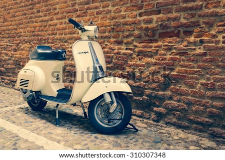 VERONA, ITALY - MAY 16, 2014: Old Vespa parked on old street in Verona, Italy. - stock photo