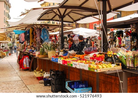 Verona,Italy- May 15,2016: People shop for food and clothes at an outdoors market in Verona,Italy
