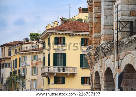 VERONA, ITALY - MAY 7, 2014: Urban buildings near the Arena of Verona - the place of annual festival operas in Verona, Italy