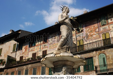 Verona,Italy,piazza delle Erbe,the statue of Donna Verona of the  fountain  of 1368