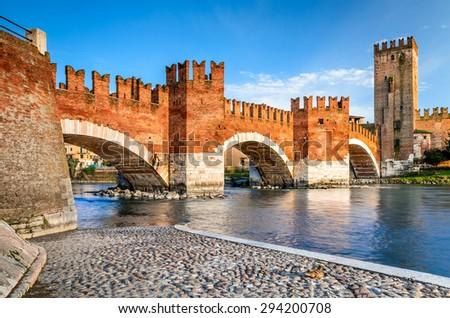 Verona, Italy. Scenery with Adige River and Ponte Scaligero and Castelvecchio, medieval landmarks of veronese city. - stock photo