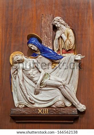 VERONA - JANUARY 28: Pieta. One part of ceramic coss way from st. Nicholas church (Chiesa di San Nicolo) on January 28, 2013 in Verona, Italy.  - stock photo