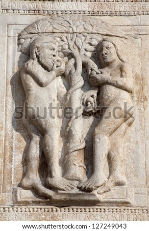 VERONA - JANUARY 27: Relief of Adam and Eva from facade of romanesque Basilica San Zeno. Reliefs is work of the sculptor Nicholaus and his workshop on January 27, 2013 in Verona, Italy.