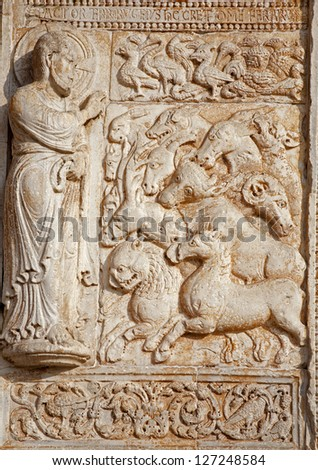 VERONA - JANUARY 27: Relief of creation from facade of romanesque Basilica San Zeno. Reliefs is work of the sculptor Nicholaus and his workshop on January 27, 2013 in Verona, Italy.