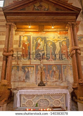 VERONA - JANUARY 27: Side altar of knotted columns. Frescos by unknown artist 14. - 15. cent. in basilica San Zeno in January 27, 2013 in Verona, Italy. - stock photo
