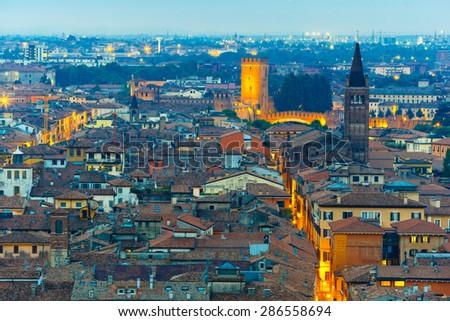 Verona skyline with Castelvecchio at night, view from Piazzale Castel San Pietro, Italy - stock photo