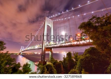 Verrazano Bridge as seen from Staten Island leading into Brooklyn, New York at night. - stock photo