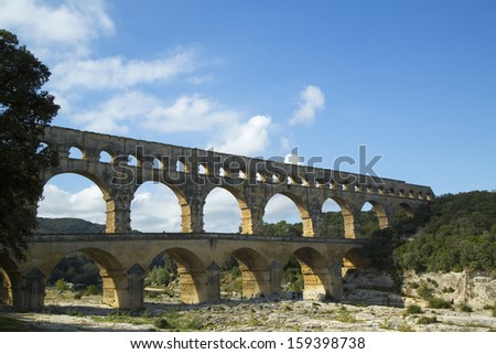VERS-PONT-DU-GARD, FRANCE -OCTOBER 13 The Pont du Gard, ancient Roman aqueduct bridge build in the 1st century AD in southern France on October 13, 2013. It is one of France's most popular attractions