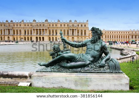 VERSAILLES, FRANCE - AUGUST 6, 2011: Statue of le Rhone at water parterre, Versailles, each of these nymphs represents a river in France.