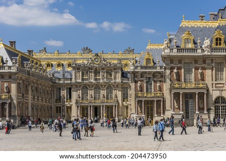 VERSAILLES, FRANCE - MAY 18, 2014: Every day many tourists wish to visit Versailles Palace. The Palace Versailles was a royal chateau. It was added to the UNESCO list of World Heritage Sites. - stock photo