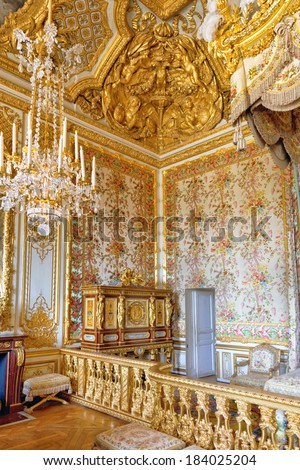 VERSAILLES FRANCE - SEPTEMBER 21 Interior of Queen's bedroom Royal Versailles, France on september 21, 2013. Palace Versailles was a Royal Chateau-most beautiful palace in France and word.  - stock photo