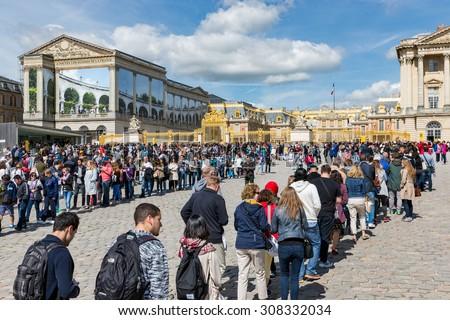 VERSAILLES PARIS, FRANCE - MAY 30: Long waiting queues of visitors on May 30, 2015 at the entrance of Palace of Versailles near Paris, France - stock photo