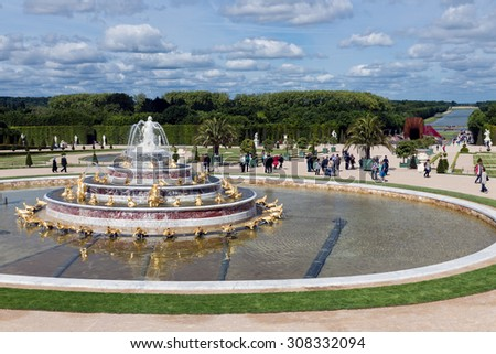 VERSAILLES PARIS, FRANCE - MAY 30: Visitors in garden Palace Versailles with ornamental pond on May 30, 2015 at the Palais of Versailles near Paris, France