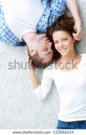 Vertical above-view image of a happy couple enjoying their moments together - stock photo