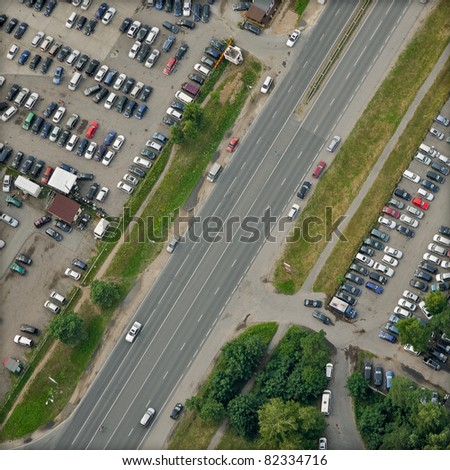 vertical aerial view over highway and parking places - stock photo