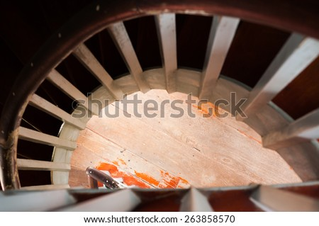 vertical and dynamic view of clean lighthouse staircase - stock photo
