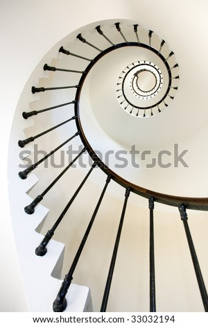 vertical and dynamic view of clean lighthouse staircase, Grave point, France. - stock photo
