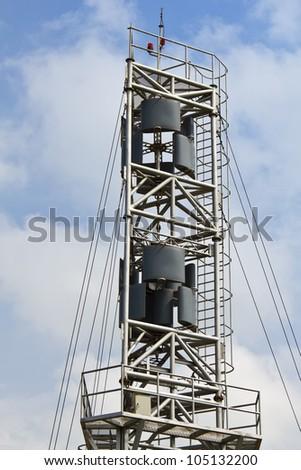 Vertical axis design wind turbine against cloudy sky, Thailand - stock photo