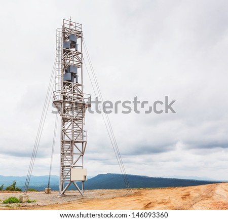 Vertical axis wind turbine tower on top of moutain - stock photo